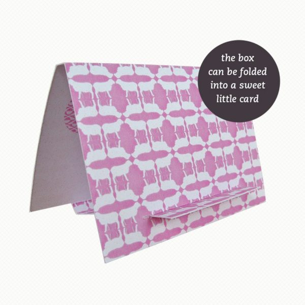 The brooch gift box can be folded out into an easel card with a dusky pink and white sheep pattern.