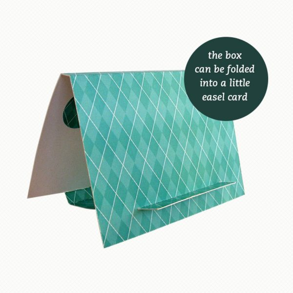 The brooch gift box can be folded out into an easel card with a bold turquoise argyle pattern